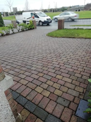 Photo of powerwashed patio with multi coloured bricks