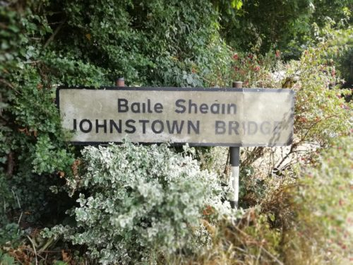 A sign for Johnstown Bridge, dirty and covered in grime, yet to be cleaned by Room with a View Window Cleaning Meath