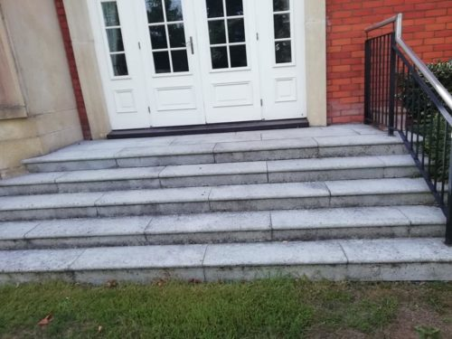 photo of steps that have been powerwashed so that they look new