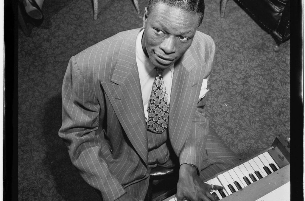 Portrait of Nat King Cole playing piano