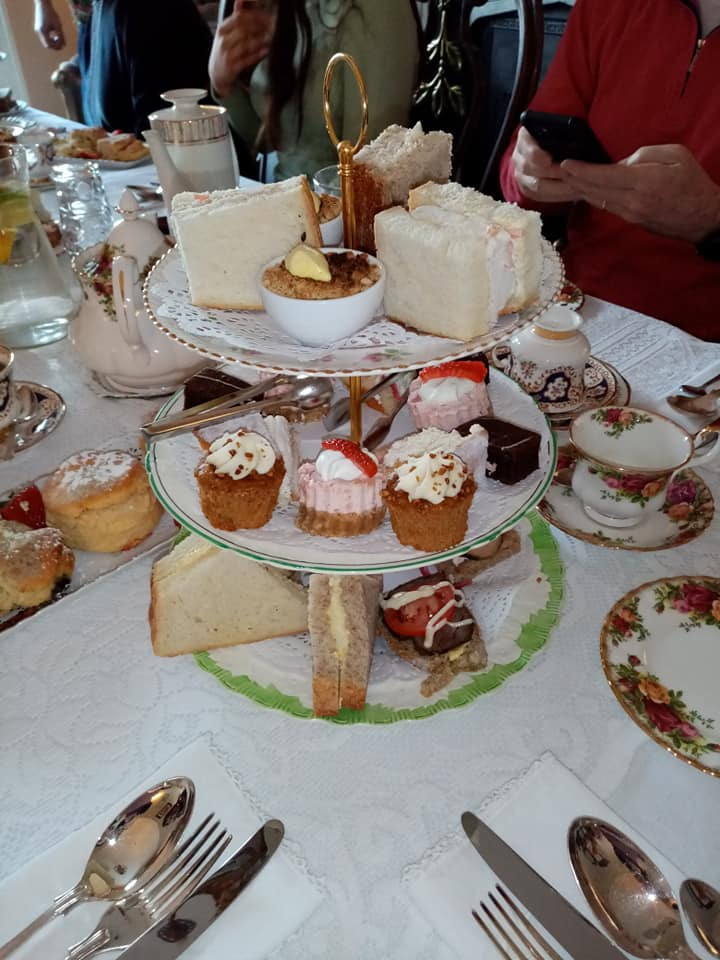 Guest enjoying afternoon tea - selection of sweet and savoury treats - The Old Rectory Trim co meath