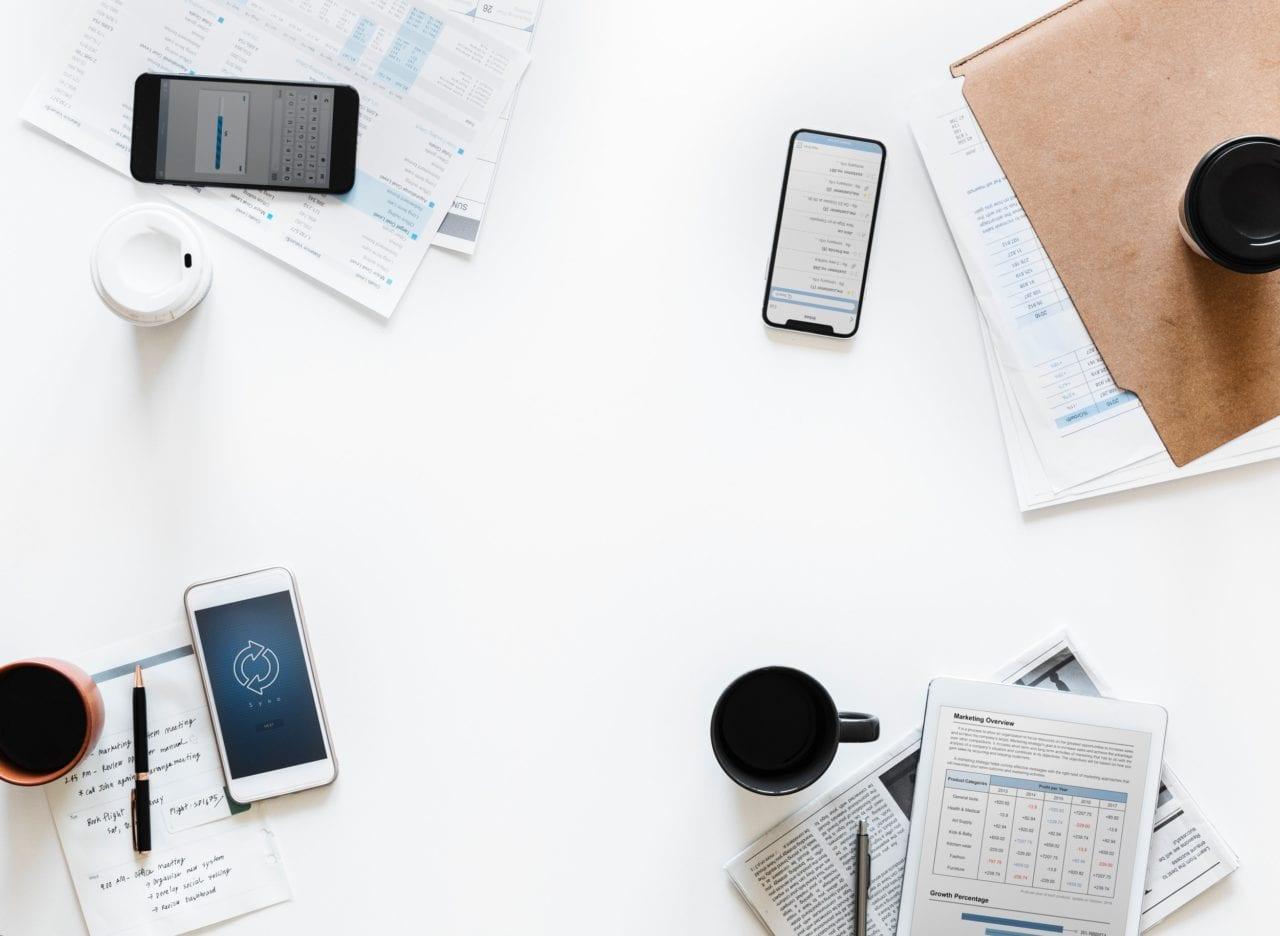 smartphones and notepads upon shared desk mission and values