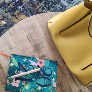 Interior design Consultation Yelow Leather Bag on modern wooden coffee table with 2021 diary