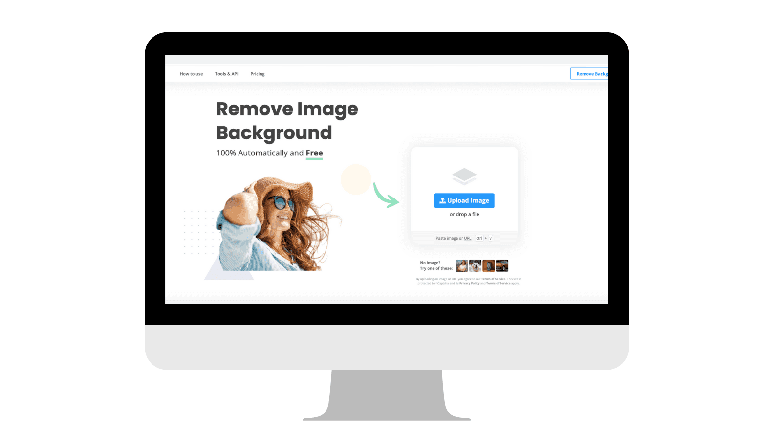 Image of a computer showing remove.bg homepage