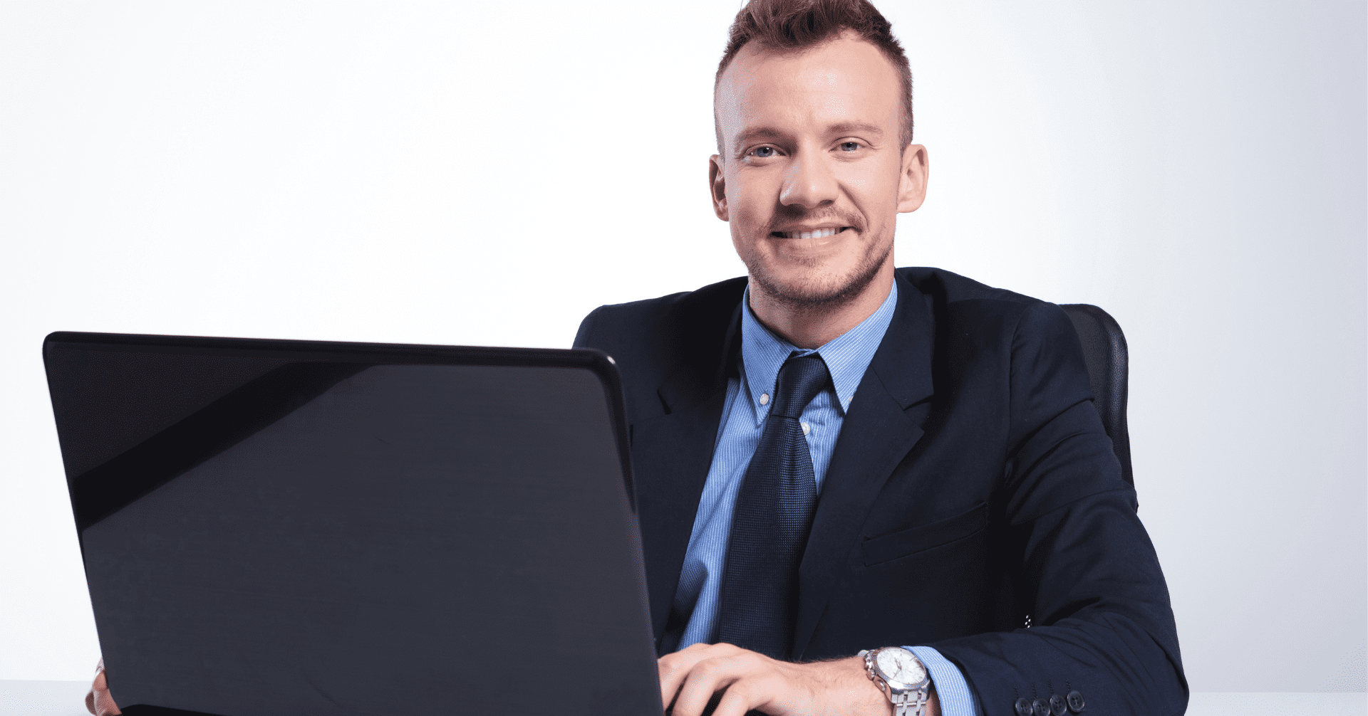 Businessman at laptop wanting a more professional online presence