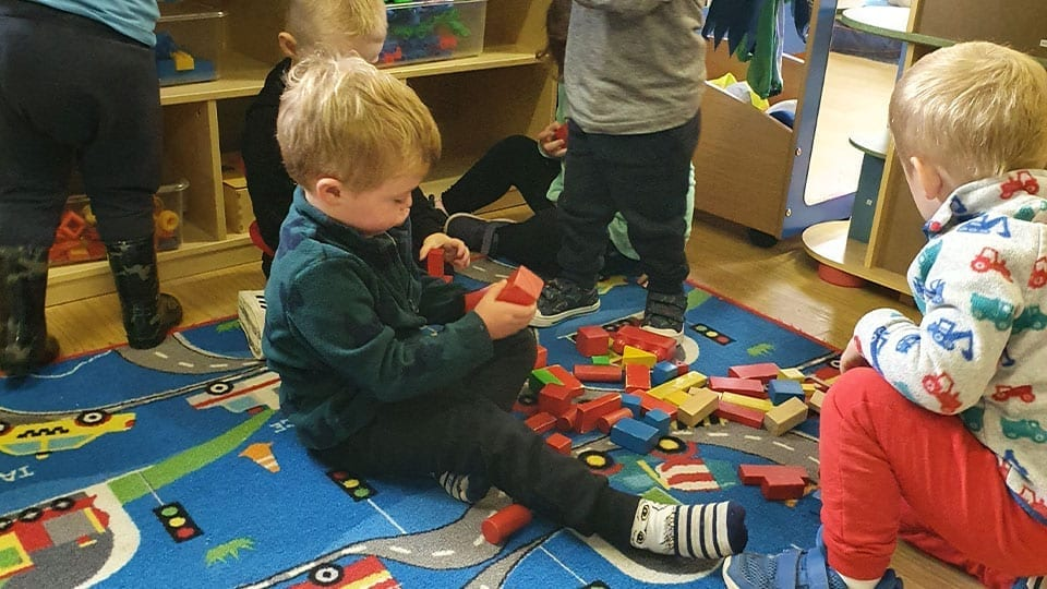 Child Playing with blocks Childcare at Mellowes