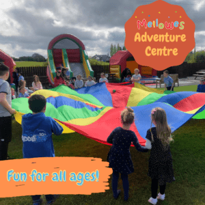 Kids playing with parachute Mellowes adventure centre Meath Ireland